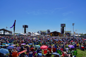 The sun shines on the crowd at a New Orleans Jazz and Heritage Festival.