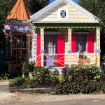 A shotgun house featuring a gingerbread trim
