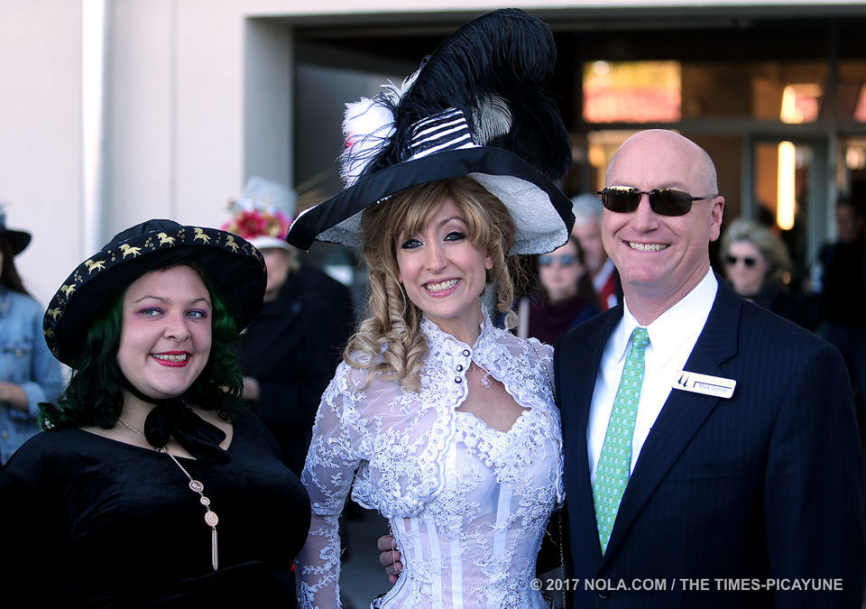 Costumed attendees of the Thanksgiving celebration at the Fair Grounds Race Course.